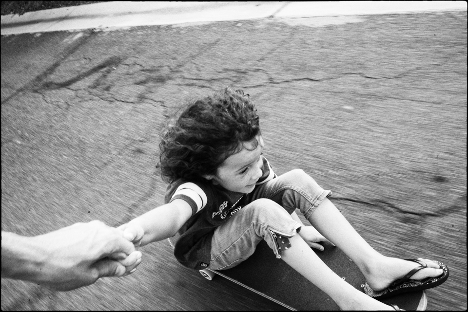 Kids being pulled along on skateboard